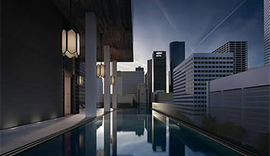 city skyline reflected on a pool